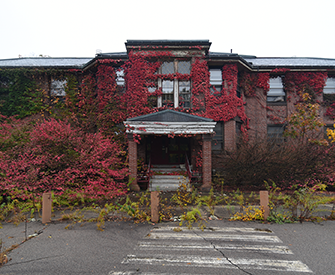The Walter E. Fernald State School, 2016. Constructed in 1906, Dolan Hall was used as a dormitory for over a century. Photograph by David Whitemyer.