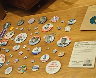 Some campaign buttons for the 1960 presidential election, pitting Senator John F. Kennedy against Vice President Richard Nixon, on display. John F. Kennedy Presidential Library, University of Massachusetts Boston.