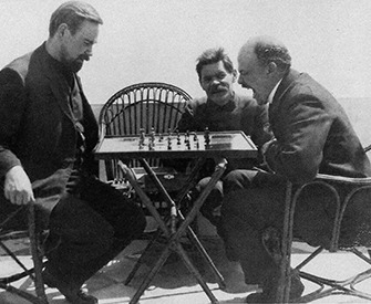 Vladimir Lenin (right) plays chess with Alexander Bogdanov (left) during a visit to Maxim Gorky (center), 1908.