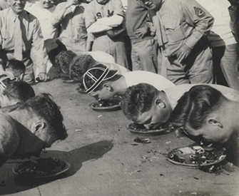 Marines stationed in North China participate in a pie-eating contest, c. 1941. Ray S. Robinson Collection (COLL/1940), U.S. Marine Corps Archives & Special Collections.