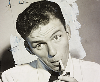 Frank Sinatra lighting a cigarette, 1944.