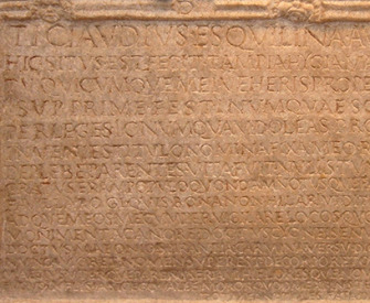 Detail of a photograph of the inscription on the tomb of Tiberius Claudius Tiberinus, Rome, by Kleuske. Wikimedia Commons (CC BY-SA 3.0).