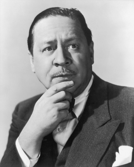 black and white head shot of Robert Benchley looking thoughtful with his hand to his chin