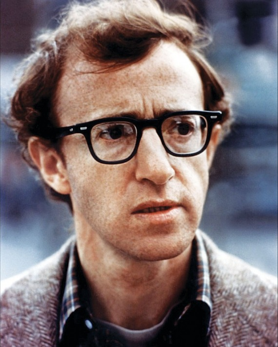 Woody Allen in thick black rim glasses