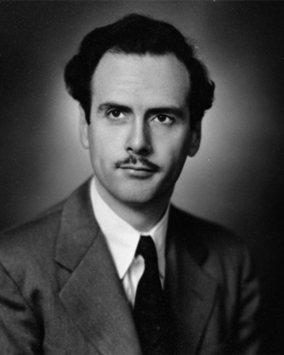 Black and white photograph of a young Marshall McLuhan with a think mustache.
