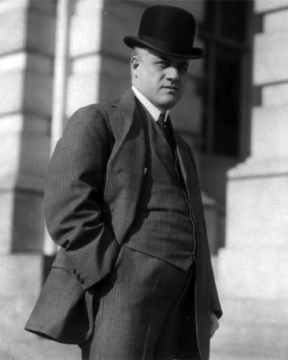 Black and white photograph of former U.S. Attorney General A. Mitchell Palmer with hands in pockets.