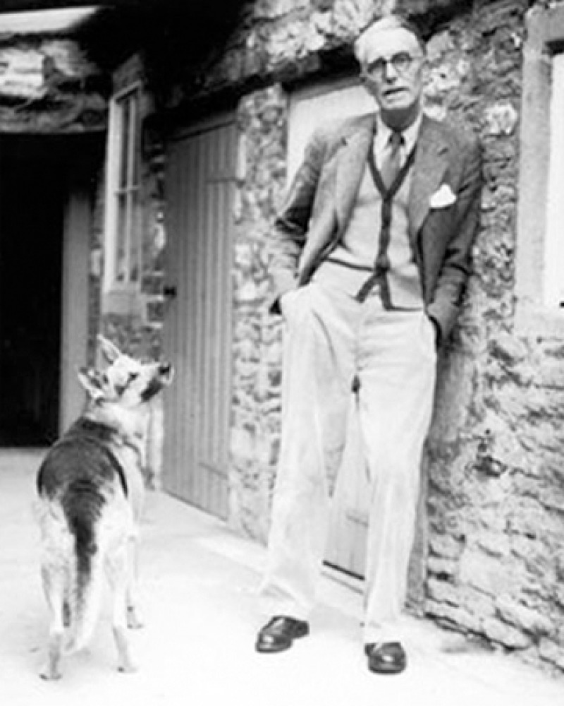 Photograph of British novelist and editor J.R. Ackerley with dog.