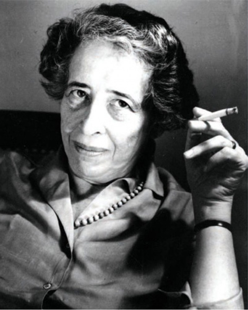 Black and white photograph of political scientist and philosopher Hannah Arendt holding a cigarette.