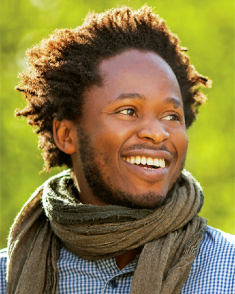 Color photograph of writer and activist Ishmael Beah.