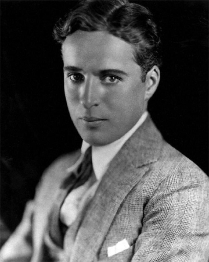 Studio headshot of a young Charlie Chaplin without his signature mustache.