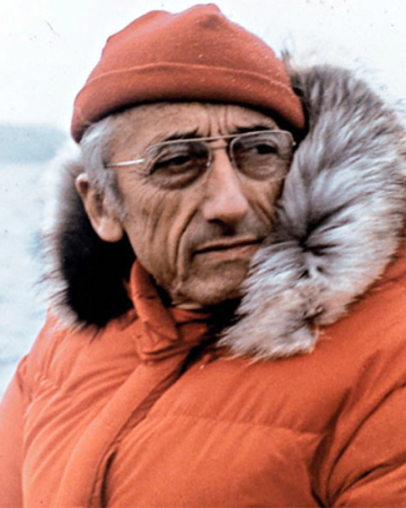 Color photograph of French oceanic explorer Jacques Cousteau in parka.
