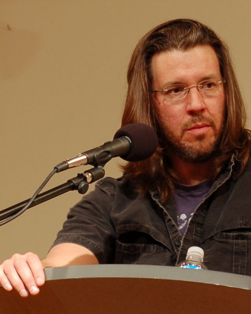 photograph of David Foster Wallace speaking at a podium
