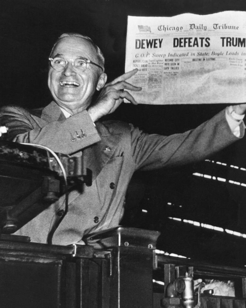 "Black and white photo of Harry S. Truman holding a newspaper with the headline ""Dewey defeats Truman"""