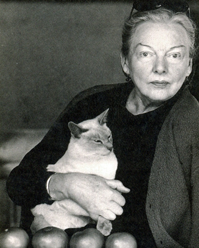 Photograph of American food writer M.F.K. Fisher with cat.