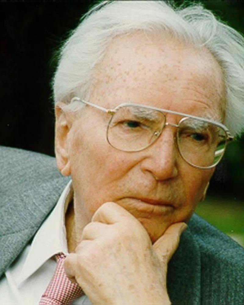 color photograph of Victor Frankl with his hand on his chin looking pensive