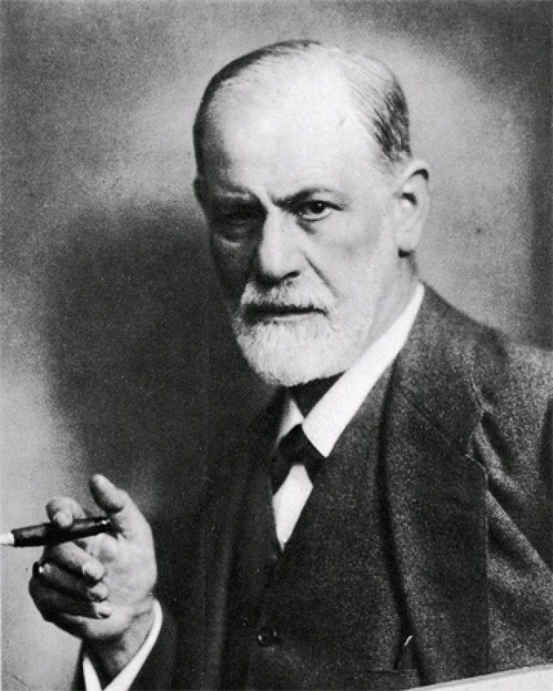 Black and white photograph of Austrian neurologist Sigmund Freud with cigar.