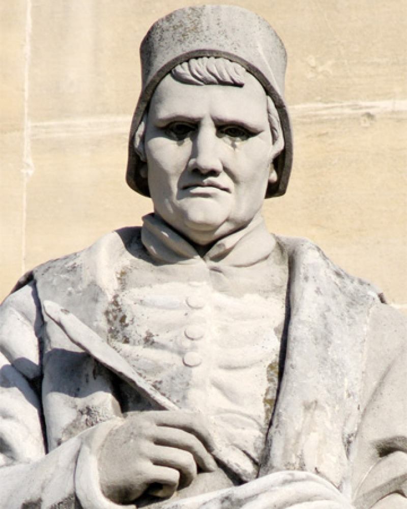 Statue of French medieval poet and historian Jean Froissart.