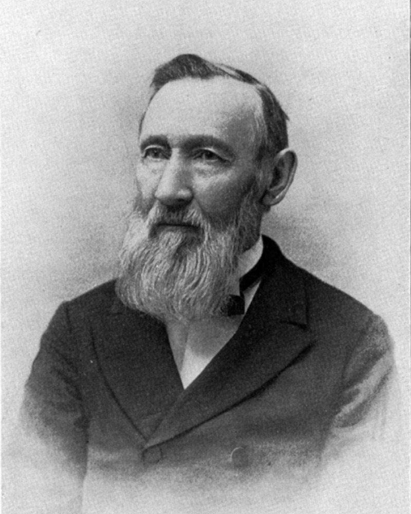 Portrait of George Vasey in a suit with a long white beard