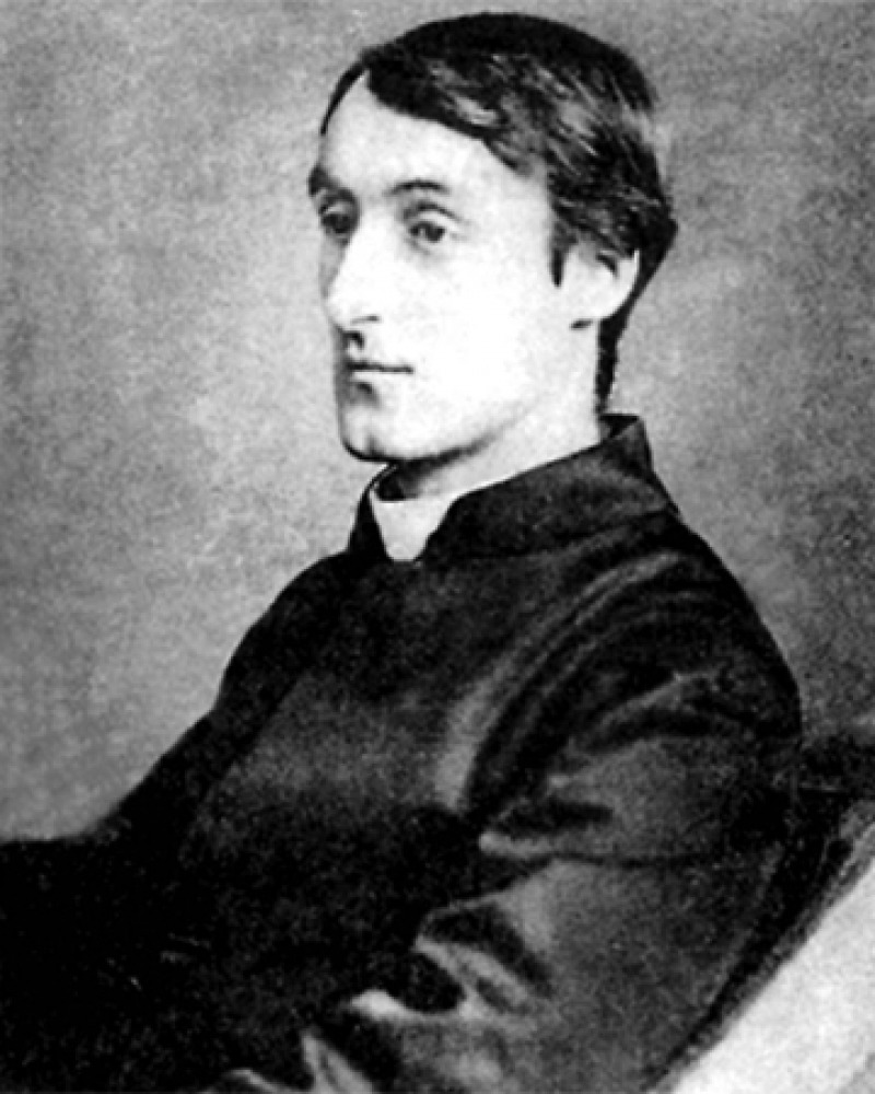 Black and white photograph of English poet and Jesuit priest Gerard Manley Hopkins.