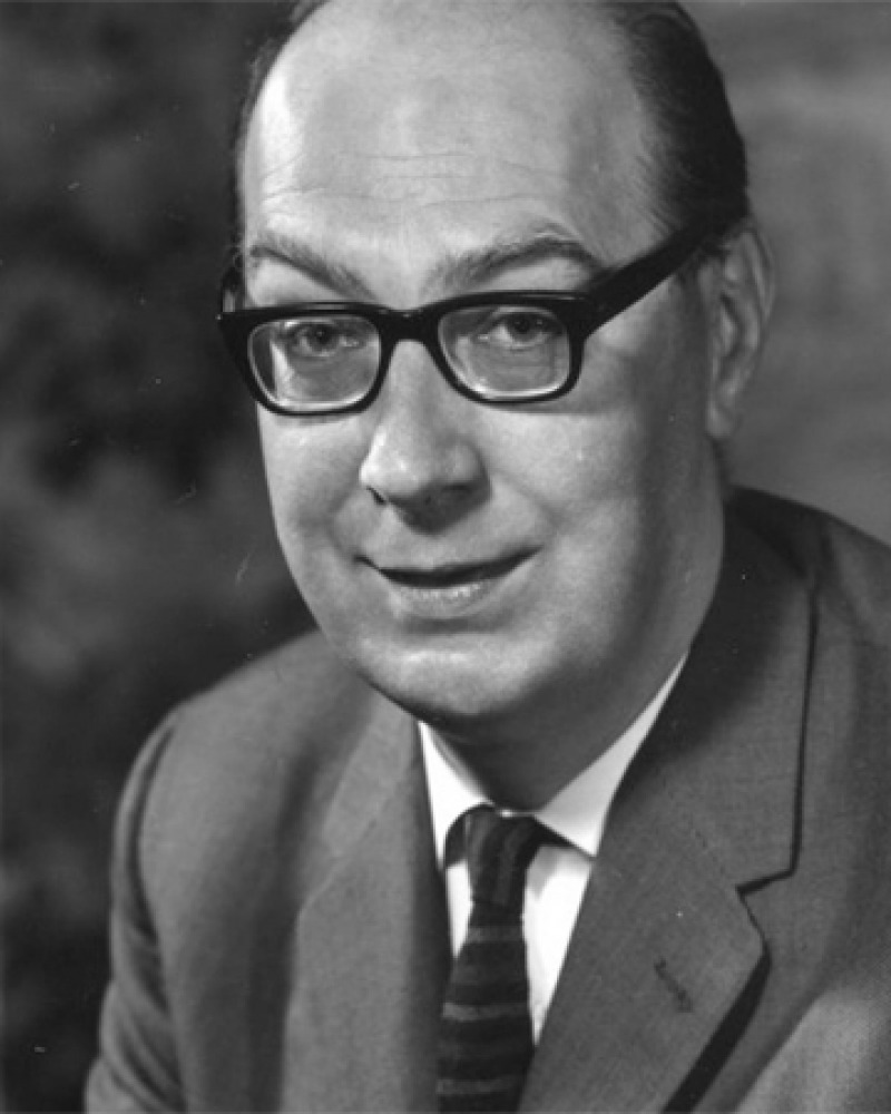 Black and white photograph of English poet and librarian Philip Larkin.