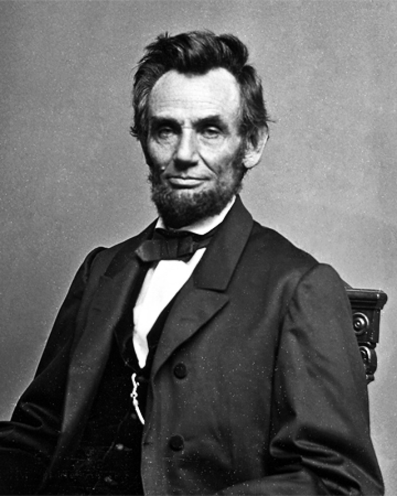 Photograph of President Abraham Lincoln sitting in a chair.