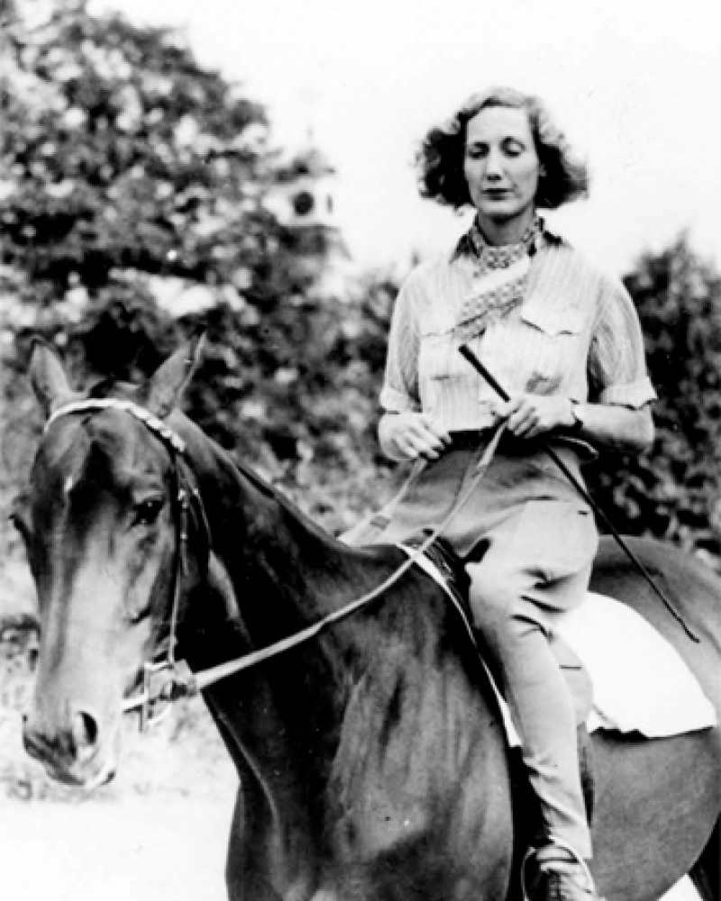 Photograph of pilot, horse trainer, writer, and adventurer Beryl Markham on horseback.