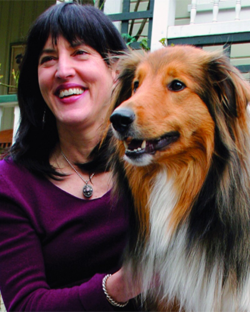 Photograph of American science writer Virginia Morell with dog.