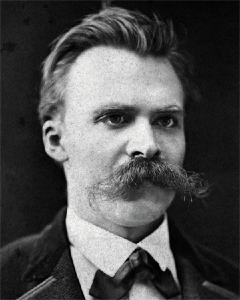 Black and white photograph of Friedrich Nietzsche with a huge mustache.