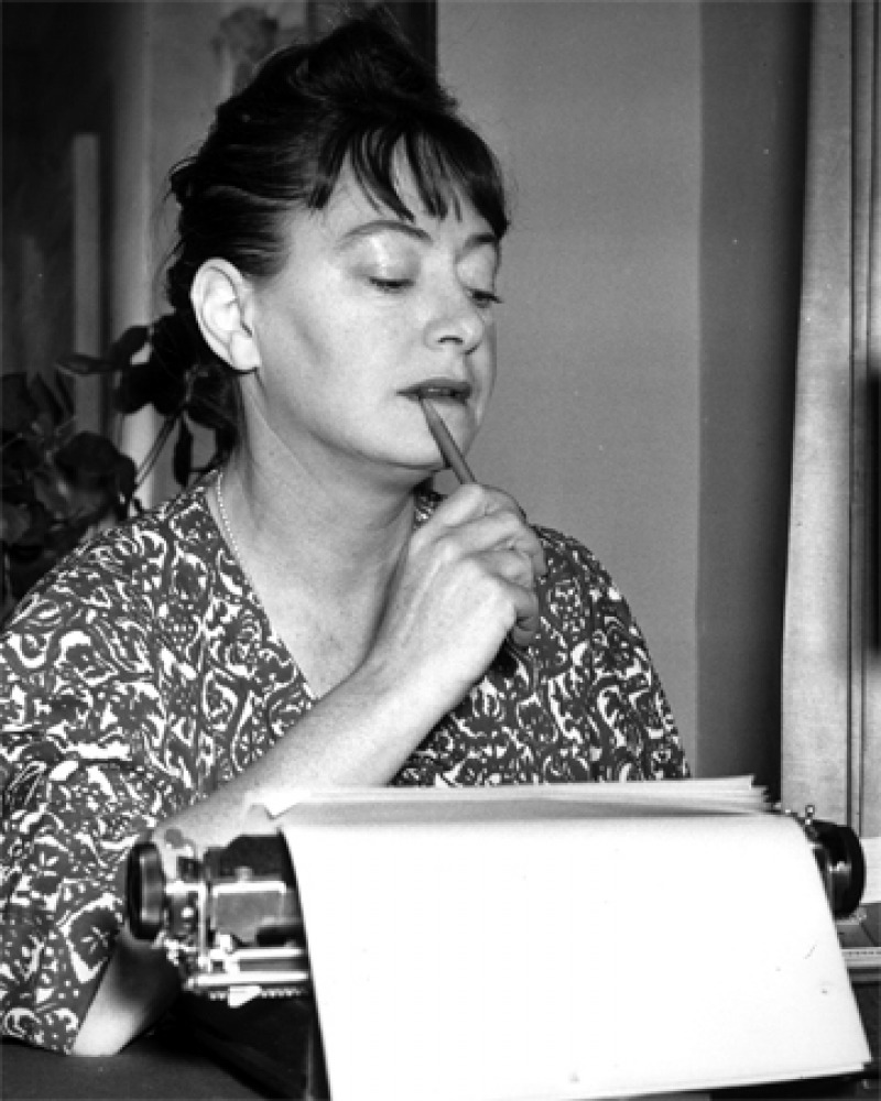Dorothy Parker working at her typewriter.