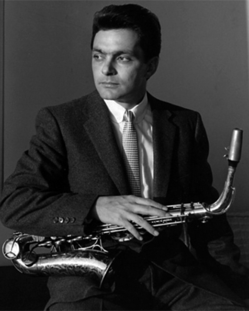 Photograph of American jazz musician Art Pepper with saxophone.