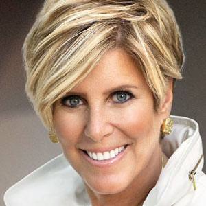 A photograph of Suze Orman. She has gold earrings and short blond hair.