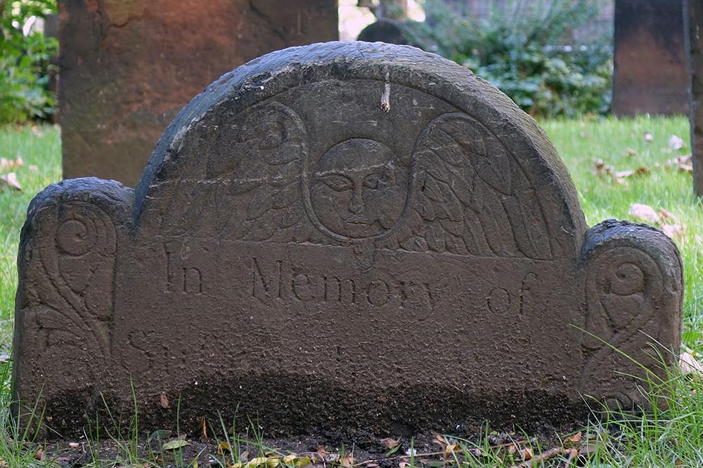 A gravestone at Trinity Churchyard in Manhattan, 2018. Photograph by Allison C. Meier.