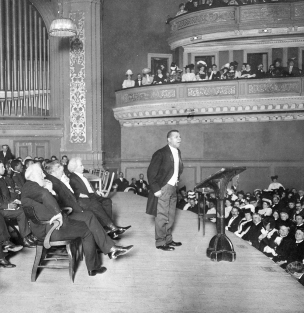 Booker T. Washington holds a Carnegie Hall audience spellbound during his Tuskegee Institute Silver Anniversary lecture, 1906. Wikimedia Commons, The New York Times.