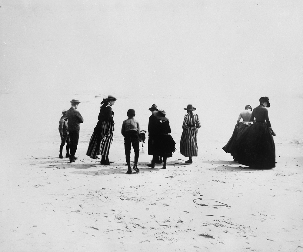 Photograph of a small group of adults and children in dresses and suits on the beach, Coney Island, Brooklyn, by Breading G. Way, c. 1888. Brooklyn Museum, Brooklyn Museum/Brooklyn Public Library, Brooklyn Collection.